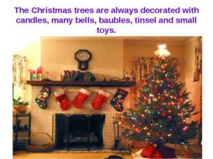The Christmas trees are always decorated with candles, many bells, baubles, t