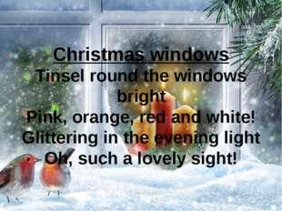 Christmas windows Tinsel round the windows bright Pink, orange, red and white