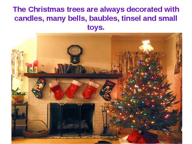 The Christmas trees are always decorated with candles, many bells, baubles, t...