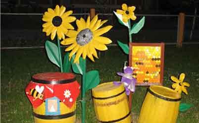 Цветы из пластиковых бутылок для клумбы: подсолнухи и хризантемы
