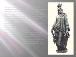 The statue is a classical female figure of Freedom wearing flowing draperies