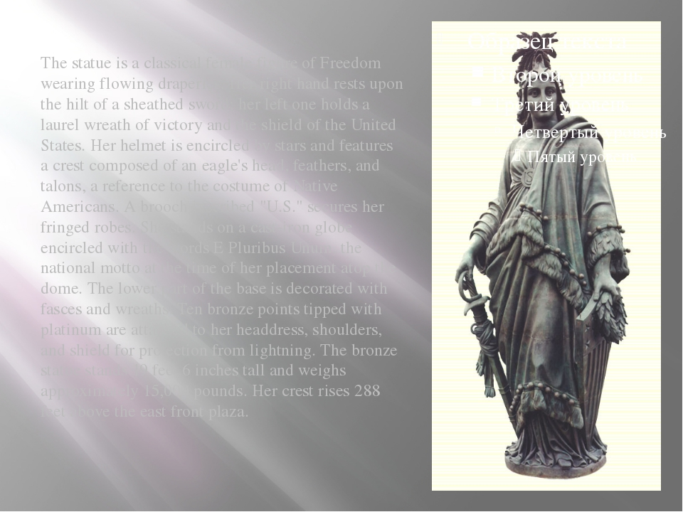 The statue is a classical female figure of Freedom wearing flowing draperies...