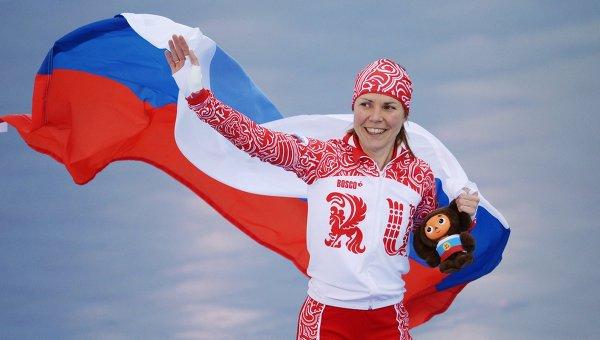 Ольга Граф (Россия), занявшая третье место на дистанции в забеге на 3000 метров в соревнованиях по конькобежному спорту среди женщин на XXII зимних Олимпийских играх в Сочи