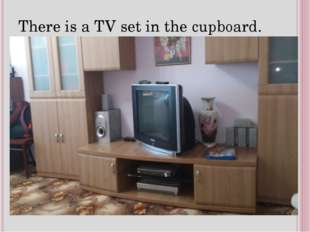 There is a TV set in the cupboard.
