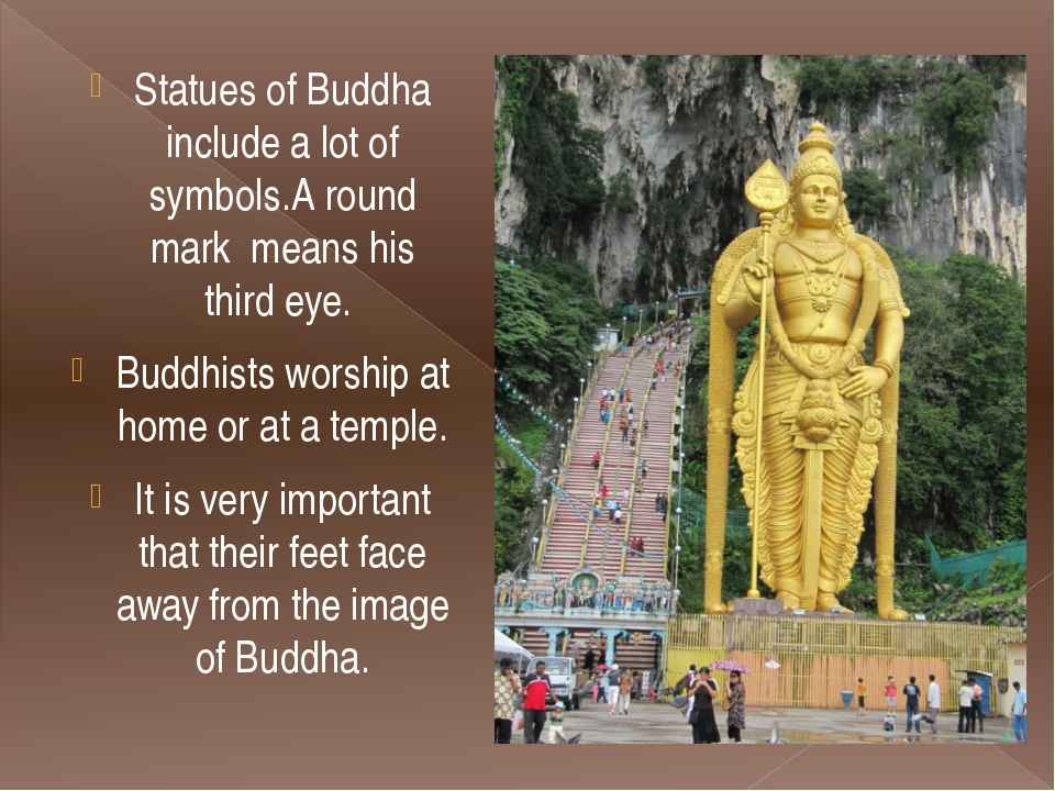 Statues of Buddha include a lot of symbols.A round mark  means his third eye....