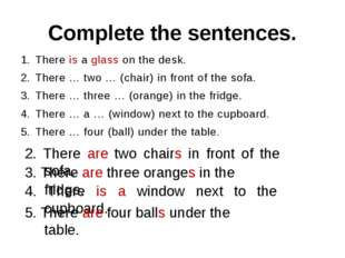 Complete the sentences. There is a glass on the desk. There … two … (chair) i