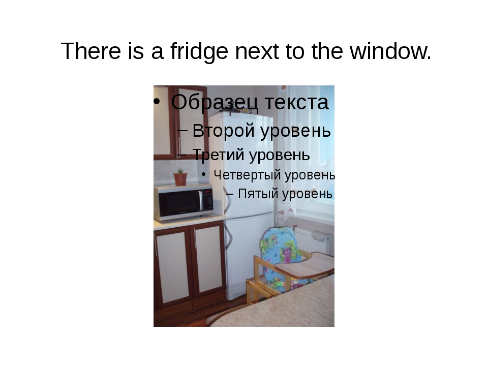 There is a fridge next to the window.