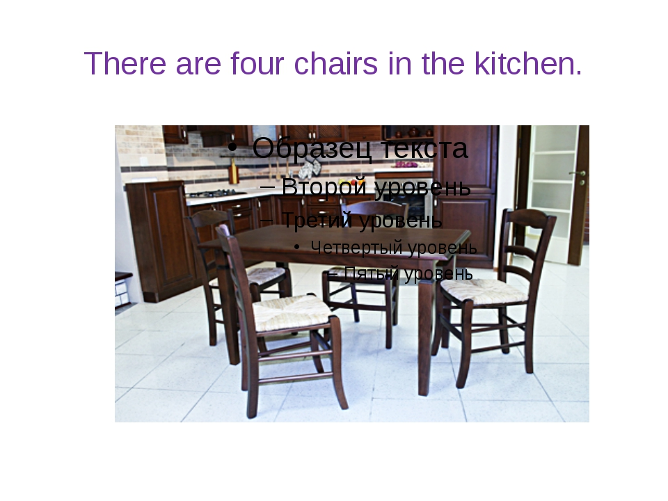 There are four chairs in the kitchen.