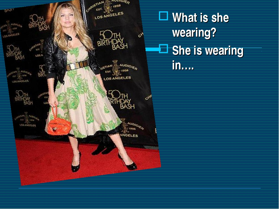 What is she wearing? She is wearing in….