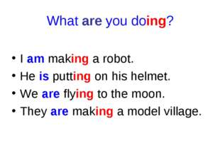 What are you doing? I am making a robot. He is putting on his helmet. We are