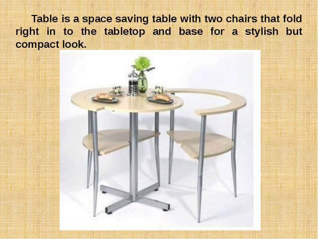 Table is a space saving table with two chairs that fold right in to the tabl...