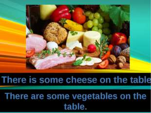 There is some cheese on the table. There are some vegetables on the table.