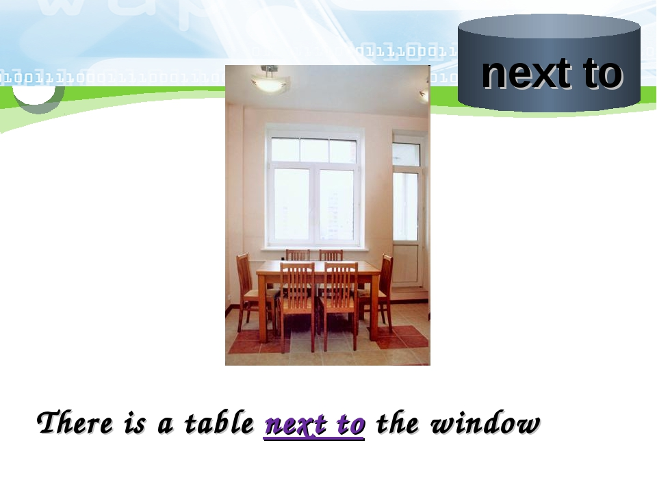 There is a table next to the window