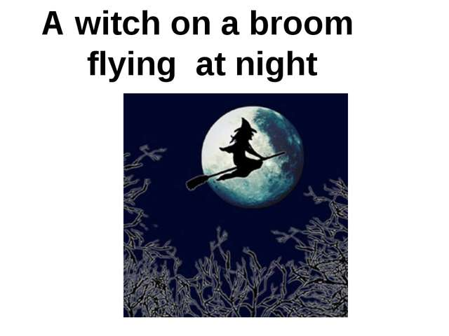 A witch on a broom flying at night