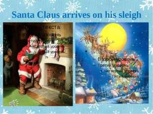 Santa Claus arrives on his sleigh