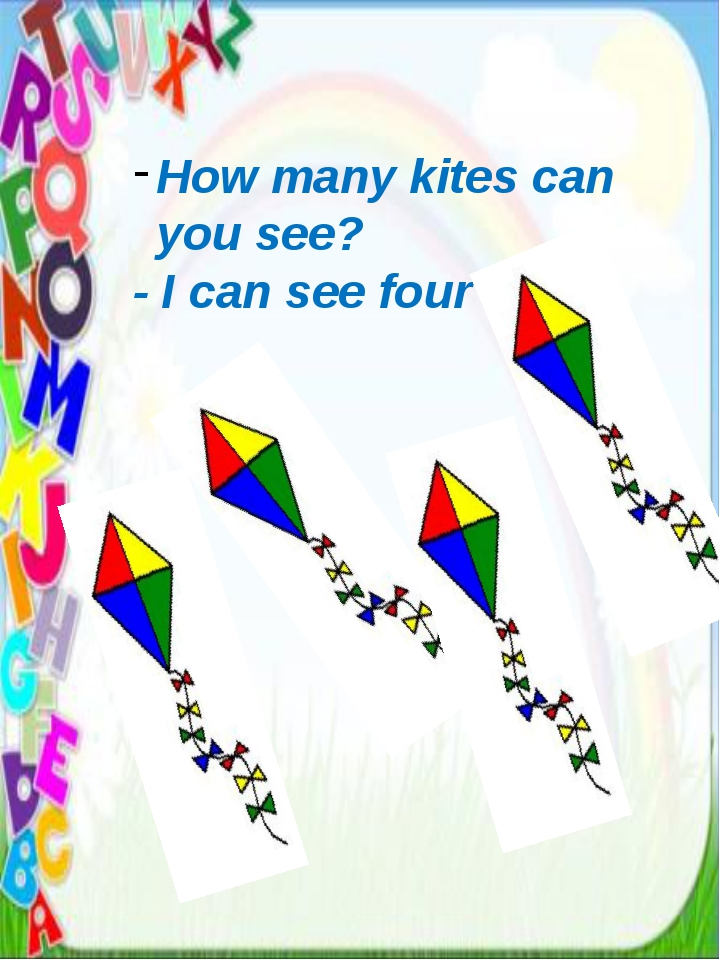 How many kites can you see? - I can see four kites.