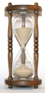 http://upload.wikimedia.org/wikipedia/commons/thumb/7/70/Wooden_hourglass_3.jpg/180px-Wooden_hourglass_3.jpg