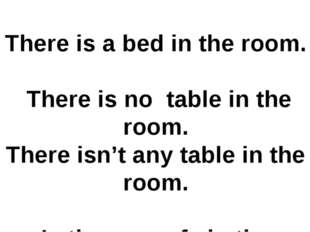 There is a bed in the room. There is no table in the room. There isn't any ta