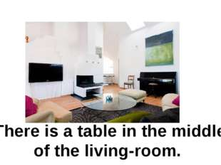 There is a table in the middle of the living-room.