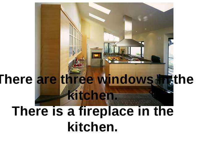 There are three windows in the kitchen. There is a fireplace in the kitchen.