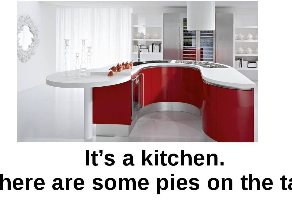 It's a kitchen. There are some pies on the table.