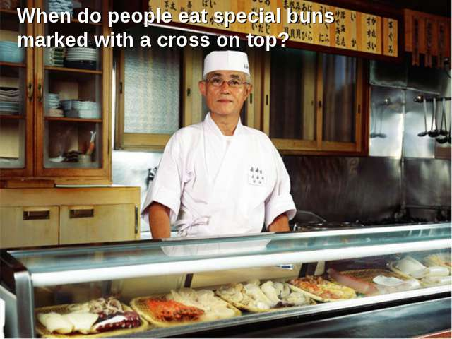 When do people eat special buns marked with a cross on top?